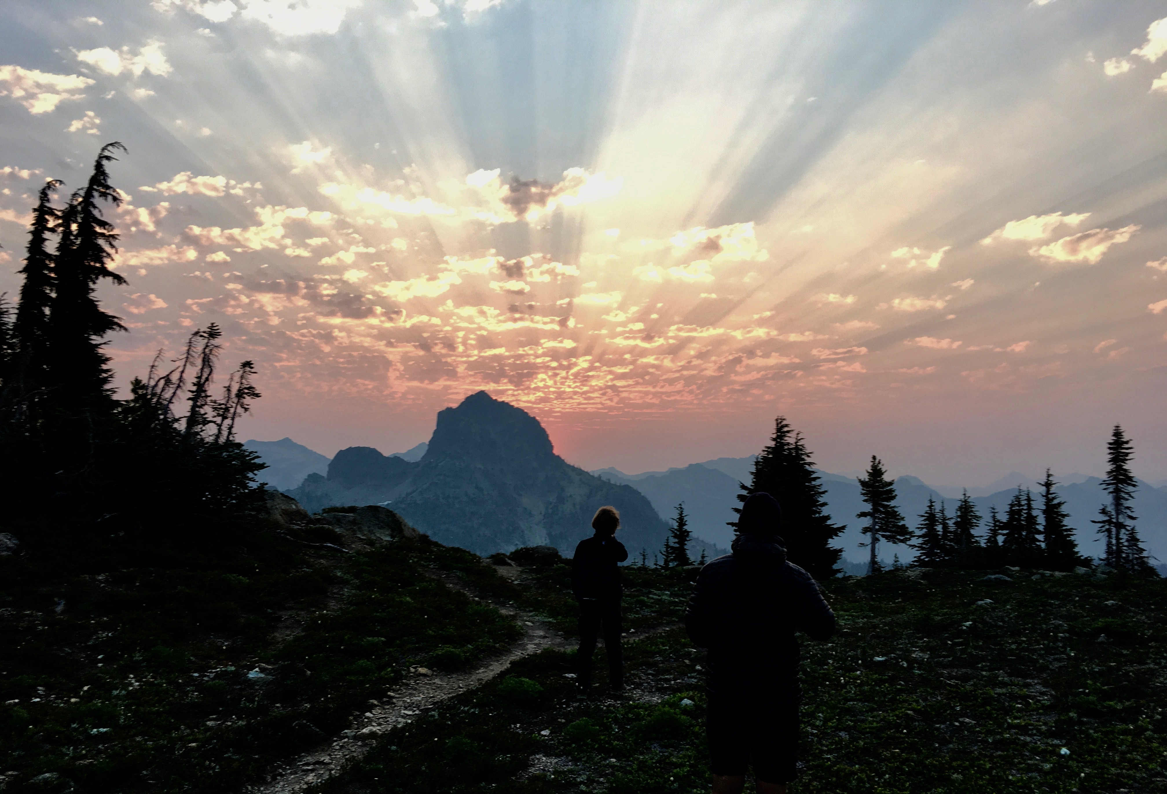 sun rays behind Cathedral Rock while Finn and Beepa are brushing their teeth.
